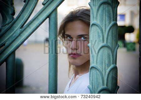 Gorgeous Long Hair Man Behind Metal Bars