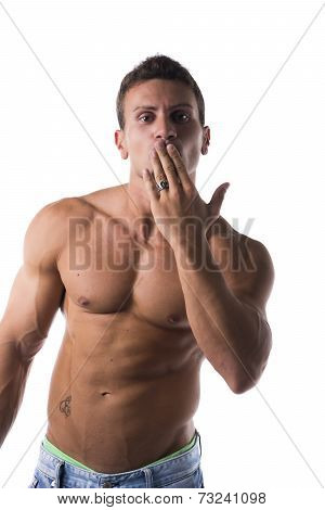 Sexy Handsome Shirtless Man Blowing A Kiss