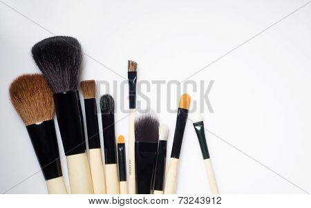 Make-up Brushes lying on white background