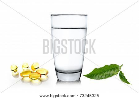 Glass Of Water Wiith Green Tea Leaf And Fish Oil Isolated On White Background