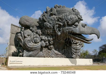 BALI, INDONESIA - SEPTEMBER 19, 2014: Tourists visit the giant monument of Garuda, a mystical bird at the Garuda Wisnu Kencana at Uluwatu, Bali Island. Bali is a world famous tourist destination.