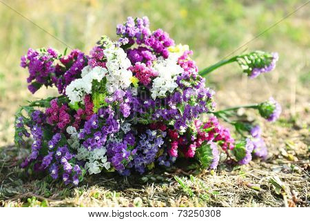 Beautiful bouquet of wildflowers on grass