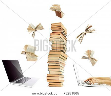 Information transfer.Books flying in tablet from laptop isolated on white