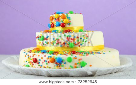 Beautiful tasty birthday cake on color background