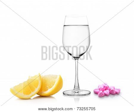 Lemon Glass Of Water And Pills Isolated On White Background