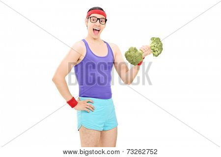 Nerdy guy holding a broccoli dumbbell isolated on white background