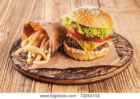 Delicious hamburger on wooden planks