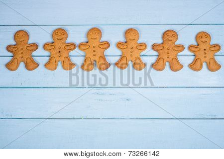 Gingerbread Man On Wooden Background
