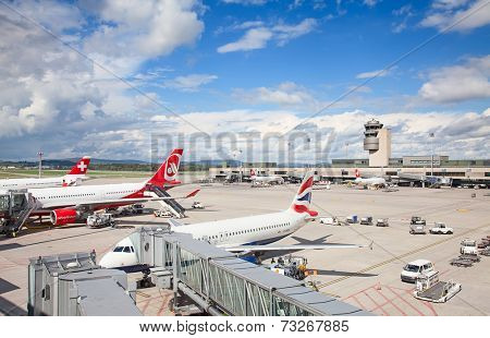 ZURICH - September 21:  Planes preparing at Terminal A Zurich Airport on September 21, 2014 in Zurich, Switzerland. Zurich airport is home port for Swiss Air and one of the biggest european hubs.