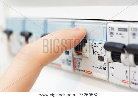 Man Turning On The Fusebox