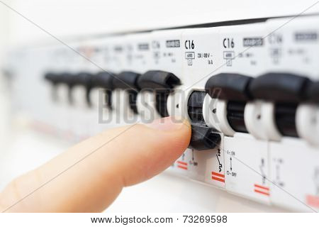 Man Turning Off The Fusebox