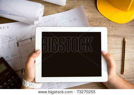 tablet architecture equipment with work tool on wooden desk