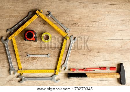 Funny construction background of different tools on the wood plank