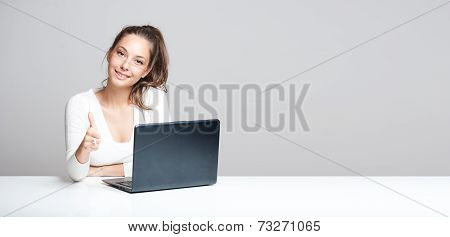 Brunette Beauty With Her Laptop.