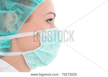 Close Up Portrait Of Young Female Doctor In Surgeon Mask