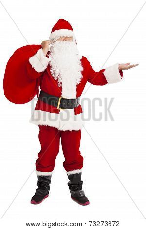 Merry Christmas Santa Claus Holding Gift Bag And Showing