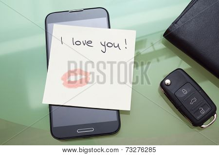 I Love You Written On A Ticket With Kiss With Lipstick  On The Smart Phone