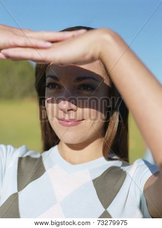 Woman shading eyes with hands
