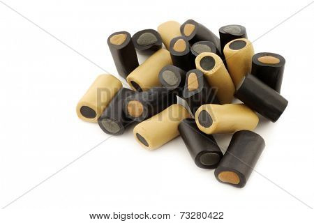 brown and black liquorice on a white background