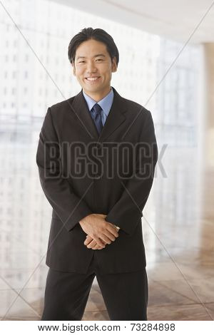 Asian businessman with hands clasped