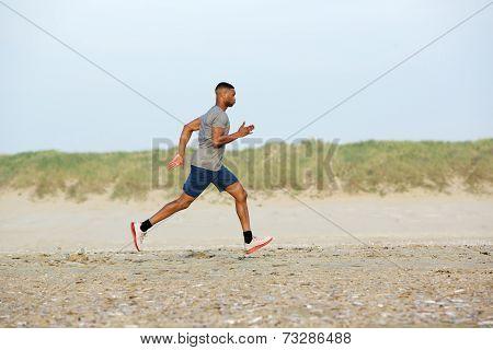Male Runner Exercising On The Beach