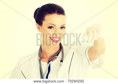 Young happy nurse with syringe