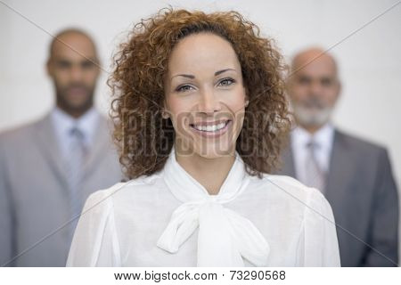 African businesswoman in front of coworkers