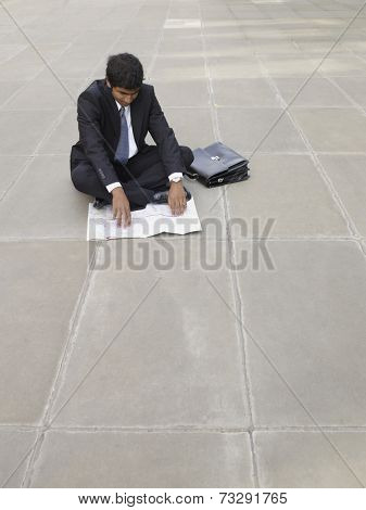 Indian businessman looking at map