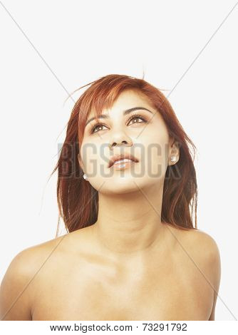 Asian woman with bare shoulders looking up