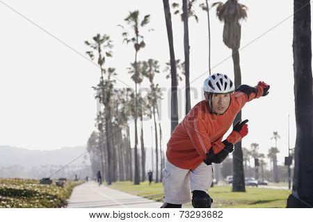 Asian man rollerblading