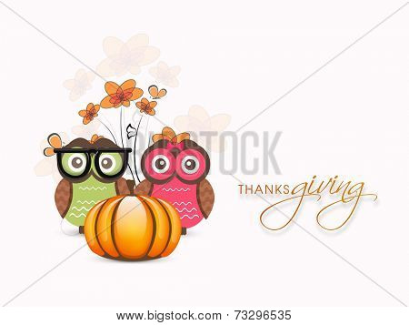 Happy Thanksgiving Day celebrations with cute owl couple and pumpkin on maple leaves decorated background.
