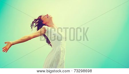 Free Happy Woman Enjoying Nature. Beauty Girl Outdoor. Freedom concept. Beauty Healthy Girl over Sky and Sun. Enjoyment