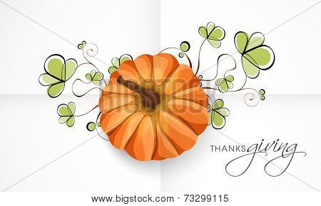 Thanksgiving Day festival celebration greeting card with pumpkin and beautiful green floral design.