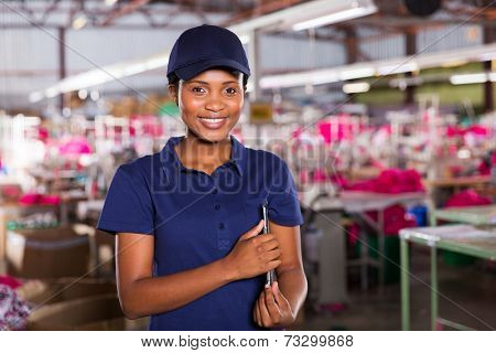 female african clothing factory supervisor with clipboard