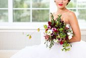 picture of floral bouquet  - Unusual wedding bouquet with succulent flowers and hop in retro style at hands of a bride