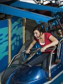 stock photo of carnival ride  - Mixed Race teenaged girl on carnival ride - JPG