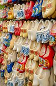 stock photo of clog  - Traditional Dutch clogs wooden shoes in a souvenir store in Amsterdam - JPG