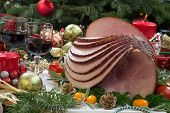 foto of smoked ham  - Christmas dinning table with glazed roasted ham with tomatoes herbs and kumquats - JPG