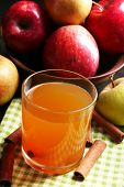 stock photo of cider apples  - Apple cider with cinnamon sticks and fresh apples on wooden background - JPG