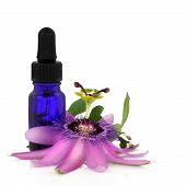 stock photo of essential oil  - Passion flower with aromatherapy blue glass dropper bottle isolated over white background - JPG