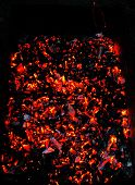 foto of ember  - Bright sparkling embers in a brazier as background - JPG