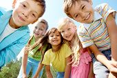 image of children group  - Portrait of happy kids outdoor looking at camera - JPG