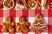 image of pecan tree  - Christmas homemade gingerbread couple and tree on tablecloth - JPG