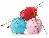 stock photo of lurex  - Colorful threads with knitting accessories isolated on a white background - JPG