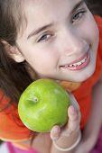 stock photo of pre-adolescent girl  - Hispanic girl holding apple - JPG