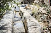 stock photo of jabal  - Closeup of water delivery system on Saiq Plateau in Oman  - JPG