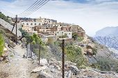 stock photo of jabal  - Image of hiking path and village Saiq Plateau in Oman - JPG
