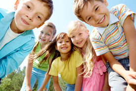 stock photo of children group  - Portrait of happy kids outdoor looking at camera - JPG