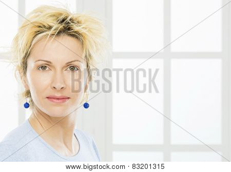 Forty years woman with blue earrings