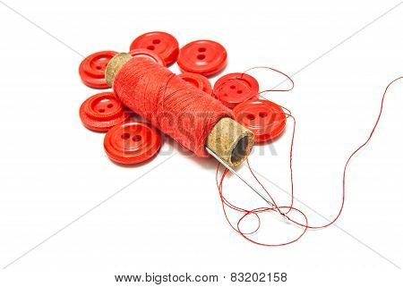 Spool Of Thread And Buttons On White
